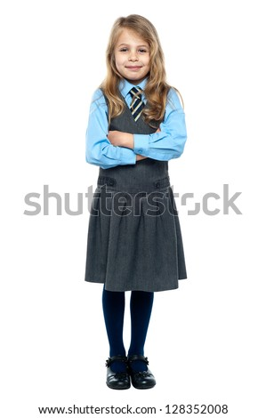 School girl posing for a picture cheerfully on white background. - stock photo