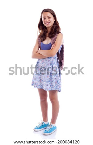 School girl standing with arms crossed against white background - stock photo