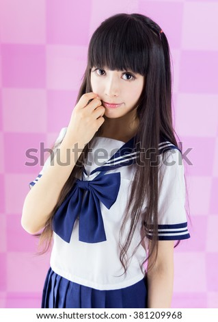 school girl student cosplay in pink background japanese style - stock photo