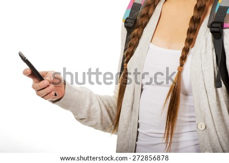 School girl texting to someone. - stock photo
