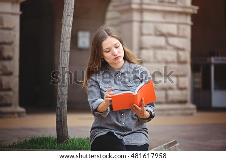 School girl with textbook