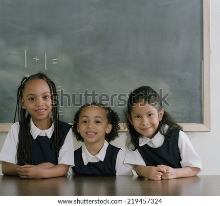 School girls smiling for the camera - stock photo