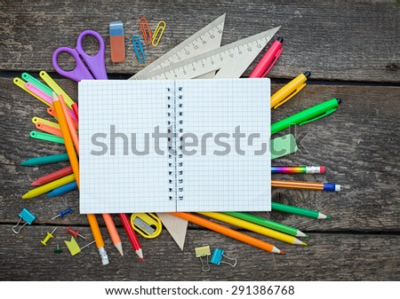 School items on a wooden table - stock photo