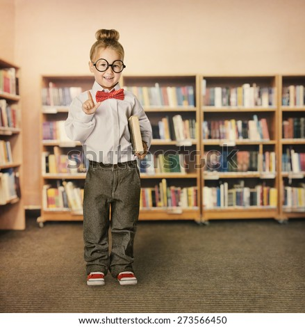 School Kid in Library, Child in Glasses with Book, Little Girl Student Finger Point Up, Bookcase Shelves - stock photo