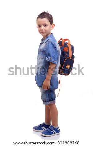 School kid standing on white background - stock photo