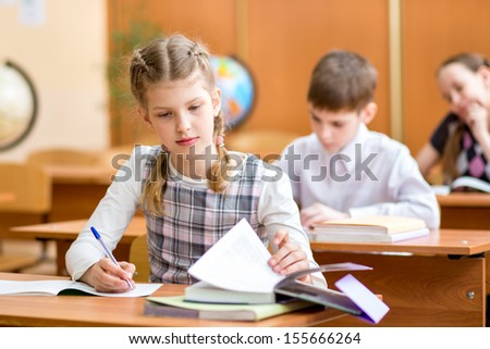 school kids at lesson - stock photo