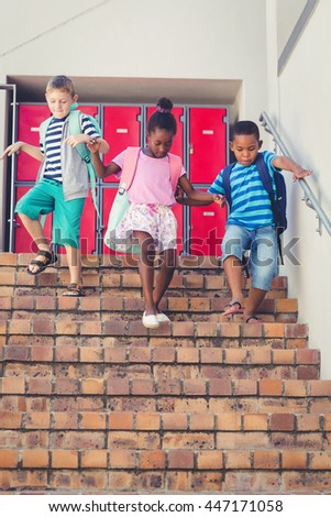 School kids getting down from staircase at school - stock photo