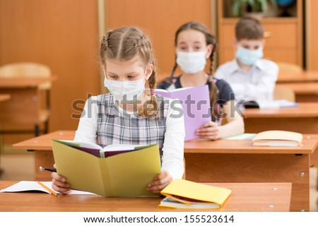 school kids with protection mask against flu virus at lesson - stock photo