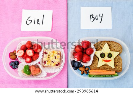 school lunch boxes for girl and boy with food in the form of funny faces. the toning. selective focus - stock photo