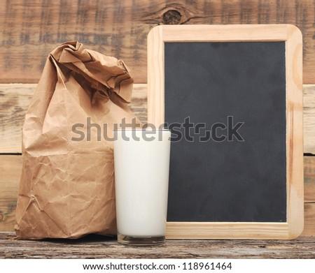 school lunch over blank blackboard - stock photo