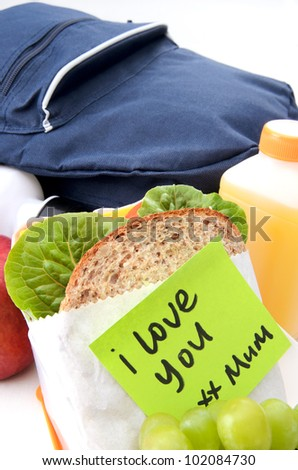 School lunch sandwich with a post-it note from mum - stock photo