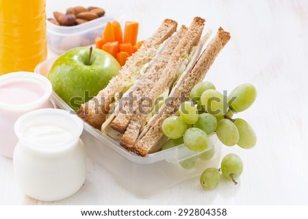 school lunch with sandwiches, fruit and yogurt, close-up, horizontal - stock photo
