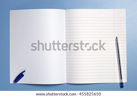 School notebook and pen on blue table, top view