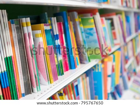 School notebooks on shelf in bookstore.