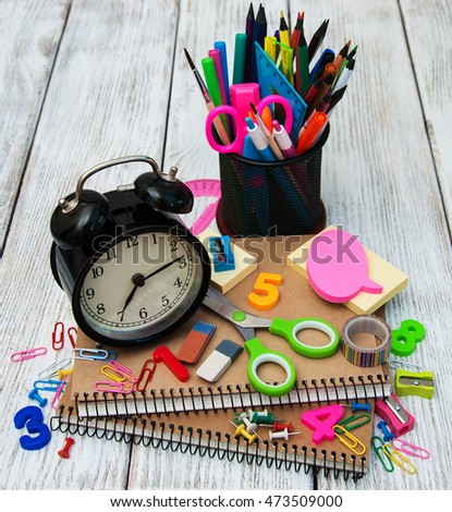 School office supplies on a wooden table