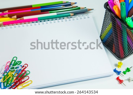 School office supplies on white background - stock photo