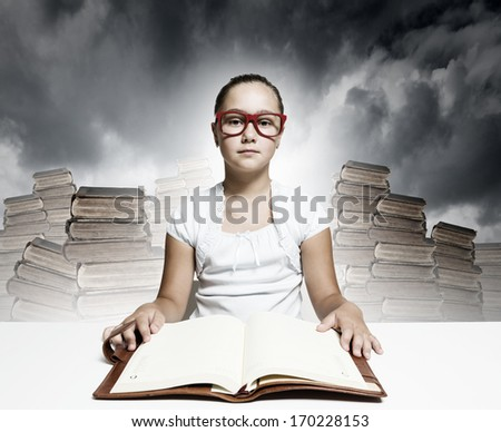 School pretty girl in red glasses reading book