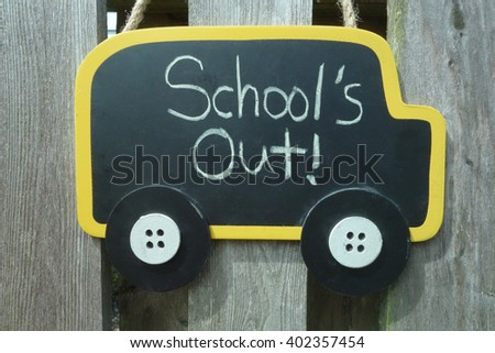 School's Out, last day of school sign in shape of school bus - stock photo
