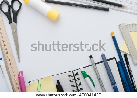 School set with back to school inscription in notebook and stationery on wooden background