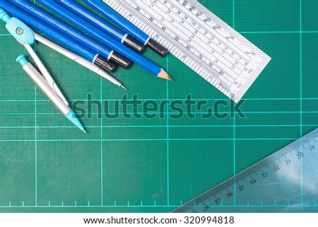 School stationery close up on cutting board. education,back to school concept. - stock photo