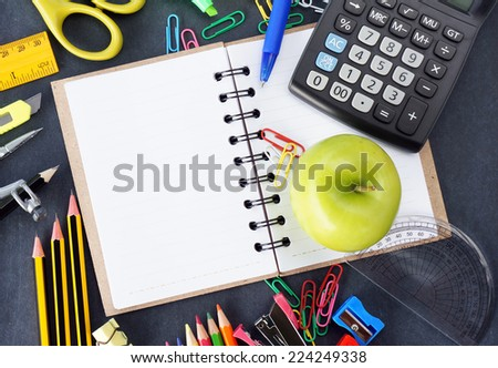 School stationery on blackboard. Back to school concept - stock photo