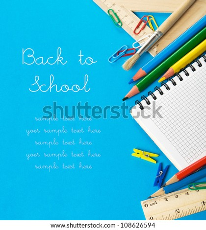 School stationery on the blue with copy space - stock photo