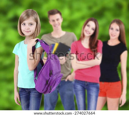 School students on nature background - stock photo