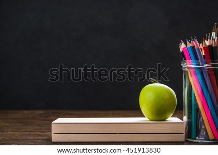 school supplies against chalkboard, copy space template - stock photo