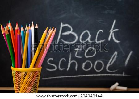 School supplies  and  blackboard. - stock photo