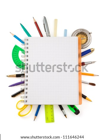 school supplies and checked notebook isolated on white background - stock photo