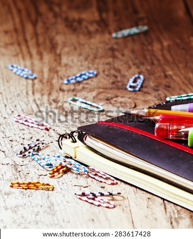 School supplies and office stationery: pens, pencils, notebooks, paper clips, selective focus - stock photo