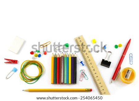 School supplies: colored pencils, wooden yardstick, erasers, binders, stationery gum, paper clips, pencil sharpener, a small clothespin, colored pins, pencil and pen isolated on white background - stock photo