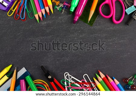 School supplies double border on a chalkboard background - stock photo