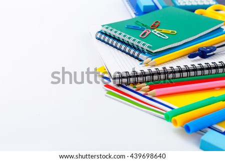 School supplies on a white background closeup with copy space. Back to school concept
