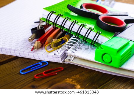 School supplies on a wooden background.