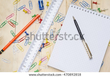 school supplies on a wooden school desk