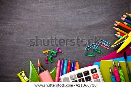 School supplies on blackboard background ready for your design - stock photo
