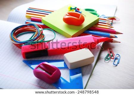 School supplies on desk, close-up - stock photo