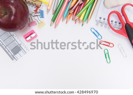 School supplies on white background ready for your design space. - stock photo