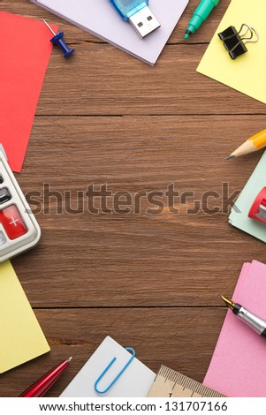 school supplies on wood background