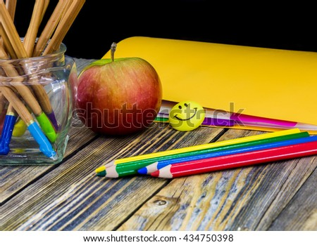 school supplies on wooden background, space for text