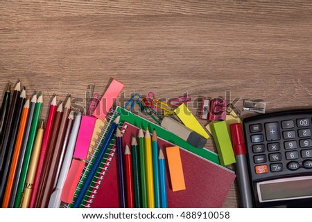 School supplies on wooden desk