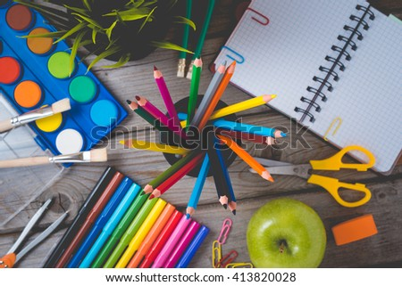 School supplies on wooden table. Close up - stock photo