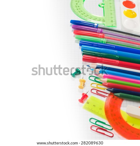School supplies: pencils, paints, markers, pens. Student and office tools on white background.