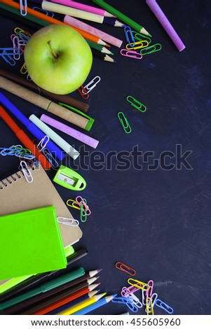 School supplies side border on a chalkboard background - stock photo