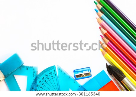 School Supplies such as colourful pencils, brushes, rulers, sharpener, eraser and stickers. Space for text. - stock photo