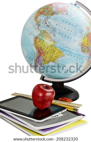 School supplies, tablet and globe isolated over a white background with clipping path included. - stock photo