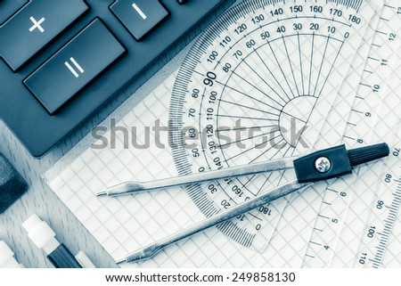School supplies used in math , geometry or  science toned in blue - stock photo