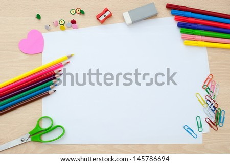 School supplies with blank paper on the school desk - stock photo
