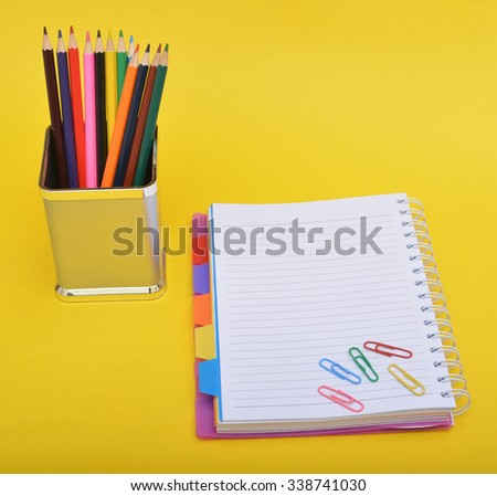 School supplies with notepad and paper holders - stock photo